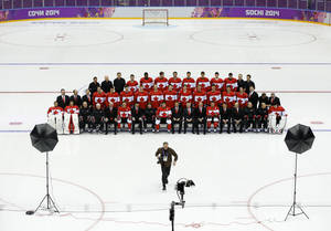 Photo - The Canadian men's ice hockey team waits as a photographer runs back to his spot to make a team photo before a training session inside the Bolshoy Ice Dome at the 2014 Winter Olympics, Tuesday, Feb. 11, 2014, in Sochi, Russia. (AP Photo/Julie Jacobson)