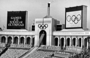 Photo - FILE - In this July 28, 1984 file photo, the Olympic flame is flanked by a scoreboard signifying the formal opening of the XXIII Olympiad after it was lit by Rafer Johnson during the opening ceremonies in the Los Angeles Memorial Coliseum. Boston, Los Angeles, San Francisco and Washington are the cities still in the running for a possible U.S. bid to host the 2024 Summer Olympics. (AP Photo/Eric Risberg, File)