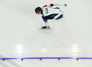 Photo - Martina Sablikova of the Czech Republic skates to win a silver medal in the women's 3,000-meter speedskating race at the Adler Arena Skating Center during the 2014 Winter Olympics, Sunday, Feb. 9, 2014, in Sochi, Russia. (AP Photo/Antonin Thuillier, Pool)