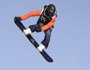 Photo - FILE - In this Jan. 18, 2013, file photo, Torah Bright, of Australia, flies over a jump during the women's slopestyle finals at the Snowboard World Championship in Stoneham, Quebec. The Australian star will compete in the halfpipe, slopestyle and snowboardcross competitions at next month's Olympics.  (AP Photo/The Canadian Press, Jacques Boissinot, File)