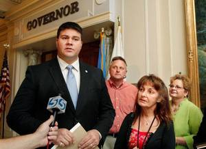photo - Sen. Ralph Shortey, R-Oklahoma City, left, talks to reporters.  At right are Chris Oliver, Karen Monahan and Cheryle Dowdy.  A small  group delivered petitions to Gov. Mary Fallin at the State Capitol Tuesday afternoon, November 1, 2011,  urging her to consider the conviction of pharmacist Jerome Ersland on murder charges. He is currently in prison at Joseph Harp Correctional Center  in Lexington for shooting a boy who attempted to rob his southwest Oklahoma City pharmacy in May, 2009.  Photo by Jim Beckel, The Oklahoman  ORG XMIT: KOD