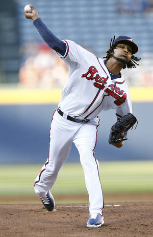 Photo - Atlanta Braves starting pitcher Ervin Santana (30) works in the first inning of a baseball game against Milwaukee Brewers Wednesday, May 21, 2014, in Atlanta. (AP Photo/John Bazemore)