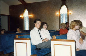 Photo - John Patrick Williams sits in church with his mother, Marie Williams. The two were found slain in their Norman home Dec. 6, 2003.  PHOTO PROVIDED BY NORMAN POLICE DEPARTMENT