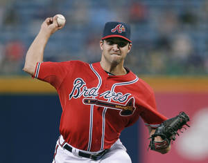 Photo - Atlanta Braves starting pitcher David Hale works in the first inning of a baseball game against the San Diego Padres in Atlanta, Friday, Sept. 13, 2013.  (AP Photo/John Bazemore)