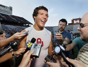 Photo - University of Oklahoma starting quarterback Sam Bradford speaks to the press before the Big Red Rally for the OU Sooner college football team at Gaylord Family-- Oklahoma Memorial Stadium in Norman, Oklahoma on Thursday, August, 23, 2007.   BY STEVE SISNEY, THE OKLAHOMAN ORG XMIT: kod