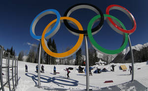 Photo - Cross country skiers pass by the Olympic rings prior to the 2014 Winter Olympics, Wednesday, Feb. 5, 2014, in Krasnaya Polyana, Russia. (AP Photo/Dmitry Lovetsky)