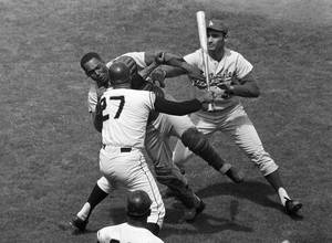Photo -   FILE - In this Aug. 22, 1965, file photo, San Francisco Giants pitcher Juan Marichal (27) swings a bat at Los Angeles Dodgers catcher John Roseboro as Dodgers pitcher Sandy Koufax, rear right, tries to break it up in the third inning at Candlestick Park in San Francisco. Violence is part of the game in many sports. But when athletes cross the line it can attract the attention of authorities _ sometimes from within their sport and in other cases from criminal prosecutors. The punishment of four members of the New Orleans Saints for participating a cash-for-hits bounty system targeting opponents is the latest example but not the only one. (AP Photo/Robert H. Houston, File)