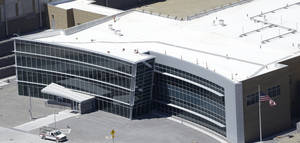 Photo - This June 6, 2013, photo, shows an aerial view of the NSA's Utah Data Center in Bluffdale, Utah. The nation's new billion-dollar epicenter for fighting global cyberthreats sits just south of Salt Lake City, tucked away on a National Guard base at the foot of snow-capped mountains. The long, squat buildings span 1.5 million square feet, and are filled with super-powered computers designed to store massive amounts of information gathered secretly from phone calls and emails. (AP Photo/Rick Bowmer)