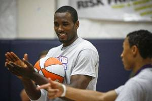 Photo - Serge Ibaka laughs during a drill at the Thunder Youth Basketball Camp at the Santa Fe Family Life Center on Tuesday, June 14, 2011. Photo by Zach Gray, The Oklahoman <strong>ZACH GRAY</strong>