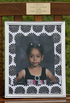 Photo - A bench with kindergarten student Evelyn De Los Santos' name and photograph was presented during a memorial at Eugene Field Elementary School in Oklahoma City, Friday, May  11,  2012. Evelyn was murdered by her father in March 2012. Photo By Steve Gooch, The Oklahoman