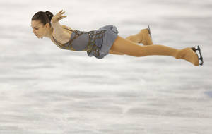 Photo - Adelina Sotnikova of Russia competes in the women's free skate figure skating finals at the Iceberg Skating Palace during the 2014 Winter Olympics, Thursday, Feb. 20, 2014, in Sochi, Russia. (AP Photo/Vadim Ghirda)