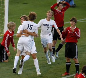 Photo - Heritage Hall's Matt McLaughlin, left, celebrates with Stefan Dolese (15), and Garrett McLaughlin (3) after a goal by  Dolese as Skiatook's Dominic Seabolt, left, Bryce Shook, and James Kriege watch during the Class 5A boys soccer championship between Heritage Hall and Skiatook in Norman, Okla., Friday, May 16, 2014. Photo by Bryan Terry, The Oklahoman