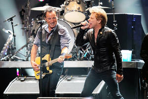 Photo - In this image released by Starpix, Bruce Springsteen, left, and Jon Bon Jovi perform during 12-12-12 The Concert for Sandy Relief at Madison Square Garden in New York on Wednesday, Dec. 12, 2012. Proceeds from the show will be distributed through the Robin Hood Foundation. (AP Photo/Starpix, Dave Allocca)