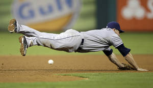 Photo - San Diego Padres third baseman Chase Headley cannot reach a single by Philadelphia Phillies' Kevin Frandsen during the sixth inning of a baseball game, Wednesday, Sept. 11, 2013, in Philadelphia. Philadelphia won 4-2. (AP Photo/Matt Slocum)