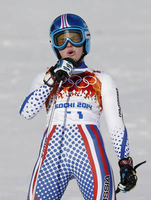 Photo - Russia's Yelena Yakovishina reacts after finishing the downhill portion of the women's supercombined in the Sochi 2014 Winter Olympics, Monday, Feb. 10, 2014, in Krasnaya Polyana, Russia.(AP Photo/Alessandro Trovati)