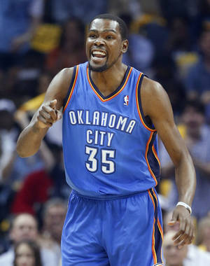 Photo - Oklahoma City Thunder forward Kevin Durant yells in the first half of Game 6 of an opening-round NBA basketball playoff series against the Memphis Grizzlies, Thursday, May 1, 2014, in Memphis, Tenn. (AP Photo/Mark Humphrey)