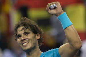 Photo - Spain's Rafael Nadal celebrates after defeating Switzerland's Stanislas Wawrinka during a quarterfinal match for the Shanghai Masters tennis tournament at the Qizhong Forest Sports City Tennis Center in Shanghai, China on Friday, Oct. 11, 2013. Nadal won 7-6, 6-1. (AP Photo/Ng Han Guan)