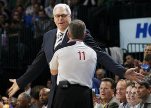 "Photo - Los Angeles head coach Phil Jackson discusses a call with official Phil Robinson March 26 at Oklahoma City. The NBA fined Jackson $35,000 Thursday for his comments about Kevin Durant and officiating, which included saying ""I think a lot of referees are treating him like a superstar."" Photo by Nate Billings, The Oklahoman."