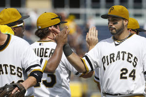 Photo - Pittsburgh Pirates' Pedro Alvarez (24) celebrates with teammates after they defeated the New York Mets in a baseball game on Sunday, June 29, 2014, in Pittsburgh. The Pirates won 5-2. (AP Photo/Keith Srakocic)