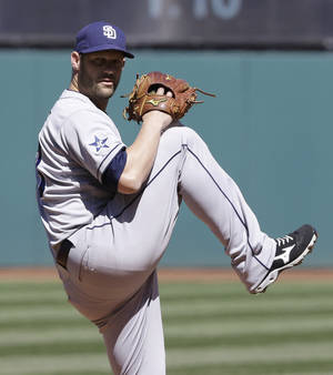 Photo - San Diego Padres starting pitcher Eric Stults delivers in the first inning in the first baseball game of a doubleheader against the Cleveland Indians, Wednesday, April 9, 2014, in Cleveland. (AP Photo/Tony Dejak)