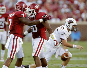 Photo - Oklahoma's Corey Nelson (7) and Frank Shannon (20) react after a stop on Louisiana Monroe's Kolton Browning (15) during the college football game between the University of Oklahoma Sooners (OU) and the University of Louisiana Monroe Warhawks (ULM) at the Gaylord Family Memorial Stadium on Saturday, Aug. 31, 2013 in Norman, Okla.  Photo by Chris Landsberger, The Oklahoman