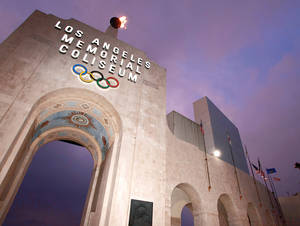 Photo - Fans could have trouble making trips to places like the Los Angeles Memorial Coliseum in an expanded Pac-10 Conference.AP PHOTO