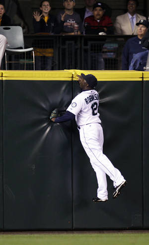 Photo -   Seattle Mariners left fielder Trayvon Robinson can't catch a two-run home run by Baltimore Orioles' Adam Jones in the 11th inning of a baseball game, Wednesday, Sept. 19, 2012, in Seattle. (AP Photo/Ted S. Warren)