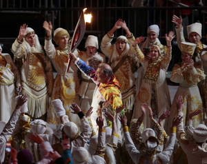 Photo - Vladislav Tretiak carries the torch during the opening ceremony of the 2014 Winter Olympics in Sochi, Russia, Friday, Feb. 7, 2014. (AP Photo/Ivan Sekretarev)