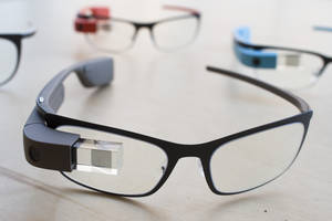 "Photo - The new Google Glass ""Bold"" prescription frames in ""shale"" color rests on a table at the Google Glass Basecamp space at Chelsea Market, Friday, Jan. 24, 2014, in New York. (AP Photo/John Minchillo)"