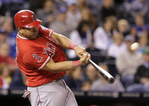 Photo -   Los Angeles Angels' Kendrys Morales hits a two-run home run during the eighth inning of a baseball game against the Kansas City Royals, Friday, Sept. 14, 2012, in Kansas City, Mo. (AP Photo/Charlie Riedel)