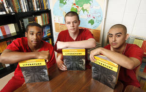 Photo - From left to right, Deauntre Smith, Austin Hartsell and Jose Rangel, each 17, pose Wednesday for a photo in their classroom behind bars at the Oklahoma County jail in Oklahoma City. Photo By Steve Gooch, The Oklahoman