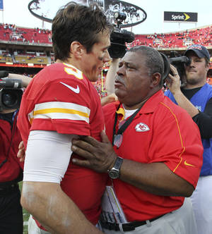 photo - Kansas City Chiefs coach Romeo Crennel, right, talks with quarterback Brady Quinn (9) following an NFL football game against the Carolina Panthers at Arrowhead Stadium in Kansas City, Mo., Sunday, Dec. 2, 2012. The Chiefs defeated the Panthers 27-21. The win came one day after Chiefs' Jovan Belcher fatally shot his girlfriend and later turned a gun on himself as GM Scott Pioli and Crennel looked on. (AP Photo/Colin E. Braley)