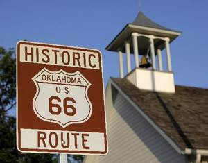 photo - Route 66 sign near the 1889 Territorial Schoolhouse at 124 E Second Street in Edmond. Photo by Nate Billings