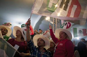 photo -   Supporters of Enrique Pena Nieto, presidential candidate for the Revolutionary Institutional Party (PRI) gather at party headquarters as exit polls begin to come in for general elections in Mexico City, Mexico, Sunday, July 1, 2012. Pena Nieto is leading Mexico's elections with about 40 percent of the vote, exit polls showed Sunday, signaling a return of his long-ruling party to power after a 12-year hiatus. (AP Photo/Alexandre Meneghini)
