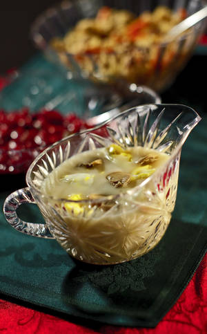photo - Gravy, cranberry sauce and rice pilaf can add merriment to your holiday feast without adding unneeded calories. <strong>CHRIS LANDSBERGER - THE OKLAHOMAN</strong>