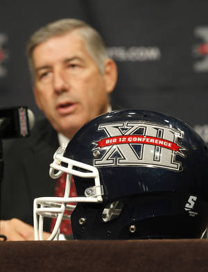 Photo - Big 12 Conference Commissioner Bob Bowlsby addresses the media at the beginning of the Big 12 Conference Football Media Days, Monday, July 22, 2013 in Dallas.  (AP Photo/Tim Sharp) ORG XMIT: TXTS102
