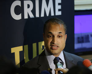 Photo - Interpol Digital Crime Centre Director Sanjay Virmani, is interviewed by reporters following a news conference Friday, May 2, 2014 at the Philippine National Police Headquarters at suburban Quezon city northeast of Manila, Philippines. Philippine police, backed by Interpol, have arrested dozens of suspected members of an online extortion syndicate who duped hundreds of victims worldwide into exposing themselves in front of webcams or engaging in lewd chats, including a Scottish teenager who committed suicide after being blackmailed, officials said.  (AP Photo/Bullit Marquez)