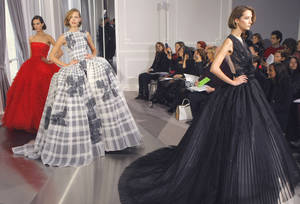 Photo - Models wear creations by British fashion designer Bill Gaytten  as part of his Dior Spring-Summer 2012 Haute Couture fashion collection for women presented Monday in Paris. AP PHOTO <strong>Jacques Brinon - AP</strong>