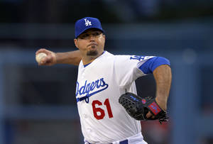 Photo - Los Angeles Dodgers starting pitcher Josh Beckett throws to the plate during the first inning of their baseball game against the Arizona Diamondbacks, Tuesday, May 7, 2013, in Los Angeles. (AP Photo/Mark J. Terrill)