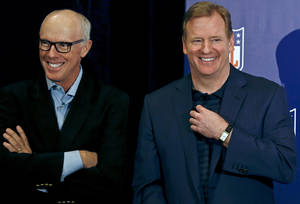 photo - NFL Commissioner Roger Goodell, right, laughs along with Rich McKay, Atlanta Falcons president and CEO and co-chairman of the competition committee, during a news conference at the annual NFL football meetings at the Arizona Biltmore, Wednesday, March 20, 2013, in Phoenix. (AP Photo/Ross D. Franklin)