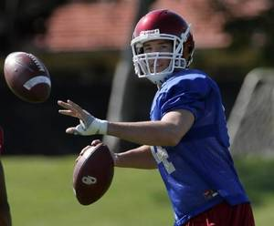 Photo - Oklahoma's Heisman Trophy winning quarterback  Sam  Bradford throws a pass during football practice Barry University in Miami, Saturday Jan. 3, 2009. Oklahoma plays Florida in the BCS Championship NCAA college football game on Thursday, Jan. 8. (AP Photo/Jeffrey M. Boan)