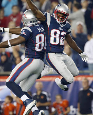 Photo - New England Patriots wide receiver Josh Boyce (82) celebrates his touchdown catch with Daniel Fells (86) during the second quarter of an NFL preseason football game against the New York Giants Thursday, Aug. 29, 2013, in Foxborough, Mass. (AP Photo/Elise Amendola)