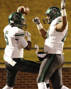 Photo - NN#5 Jake Edwards celebrates his touchdown catch with NN#88 Hunter Moody during the high school football game between Norman North and Edmond North in Edmond at Wantland Stadium Friday, Friday, October 18, 2013.  Photo by Doug Hoke, The Oklahoman