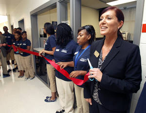 Photo - John Marshall High School Principal Aspasia Carlson speaks during a ceremony Monday for the opening of the  Tinker Federal Credit Union branch at the school in Oklahoma City. Photo by Paul Hellstern, The Oklahoman <strong>PAUL HELLSTERN</strong>