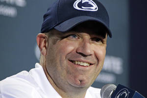 Photo -   Penn State head coach Bill O'Brien smiles during his post-game meeting with reporters after their 34-7 win over Navy in an NCAA college football game in State College, Pa., Saturday, Sept. 15, 2012. (AP Photo/Gene J. Puskar)