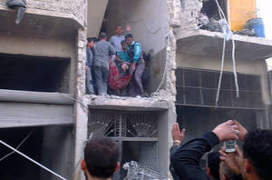 "photo - Citizen journalism image provided by Aleppo Media Center AMC which has been authenticated based on its contents and other AP reporting, Syrian citizens carry an injured man from a damaged building that was hit by a Syrian forces airstrike, on the al-Marjeh neighborhood, of Aleppo, Syria, Tuesday March 19, 2013. Syria's information minister says a chemical weapon fired by rebels on a village in the north of the country is the ""first act"" by the opposition interim government announced in Istanbul. (AP Photo/Aleppo Media Center, AMC)"