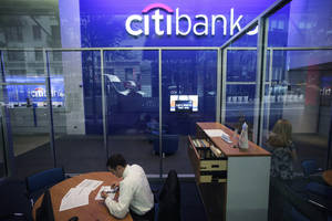 photo - FILE - This Oct. 13, 2011 file photo, shows a Citibank branch in New York.  Citigroup said Wednesday, Dec. 5, 2012, that it will cut 11,000 jobs, a bold early move by new CEO Michael Corbat. The cuts amount to about 4 percent of Citi's workforce of 262,000.  The bulk of the cuts, about 6,200, will come from Citi's consumer banking unit, which handles everyday functions like branches and checking accounts.  (AP Photo/Mark Lennihan, File)