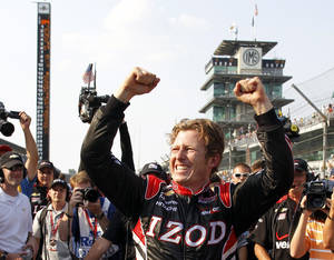 Photo - FILE - In this May 19, 2013 file photo, IndyCar driver Ryan Briscoe, of Australia, celebrates winning the pole on the first day of qualifications for the Indianapolis 500 auto race at the Indianapolis Motor Speedway in Indianapolis. Chip Ganassi has hired Briscoe to fill the final spot on his four-car team. The announcement came Friday, Dec. 13, 2013 in Indianapolis. (AP Photo/Tom Strattman, File)