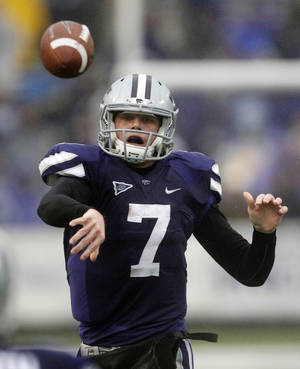 photo - FILE - In this Dec. 3, 2011, file photo, Kansas State quarterback Collin Klein (7) passes to a teammate during the first half of an NCAA college football game against Iowa State in Manhattan, Kan. Klein enters this season with Heisman Trophy buzz, but K-State won seven games by seven points or less and it's tough to repeat that kind of good fortune in a difficult conference. (AP Photo/Orlin Wagner, File) ORG XMIT: NY162