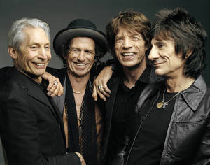 "Photo - FILE - This 2005 file photo, originally supplied by the Rolling Stones, shows members of the group, from left, Charlie Watts, Keith Richards, Mick Jagger, and Ron Wood posing during a photo shoot.  The Rolling Stones have called off their tour dates in Australia and New Zealand following the death of Mick Jagger's girlfriend and designer L'Wren Scott on Monday, March 17, 2014. The iconic band says in a statement Tuesday they ""are deeply sorry and disappointed to announce the postponement of the rest of their 14 ON FIRE tour."" (AP Photo/The Rolling Stones, Mark Seliger-File)"